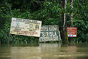 Community signs on Tiputini River bordering<br /> Yasuni National Park, Amazon Rainforest<br /> ECUADOR. South America