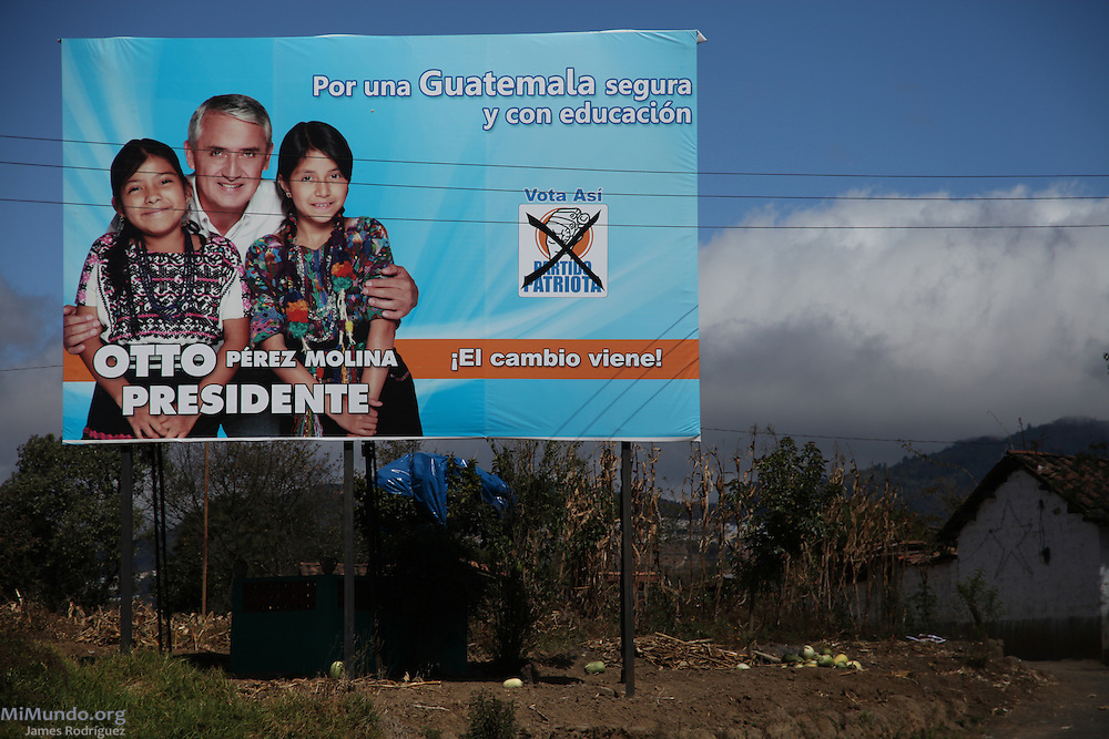 Political advertisement for President-elect and former General Otto Perez Molina. Perez Molina, who is accused of perpetrating acts of genocide against the Mayan indigenous population during the internal armed conflict in the 1980's, is pictured here with two Mayan girls. Quetzaltenango, Guatemala. November 28, 2011.
