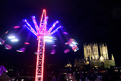 The Lincoln Cathedral seen at night from the wall walk of Lincoln Castle past one of the fair ground rides from the Lincoln Christmas Market.<br /> <br /> Picture: Chris Vaughan Photography<br /> Date: December 6, 2019