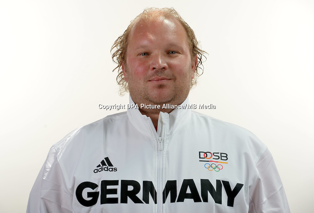 Sven Grundmann poses at a photocall during the preparations for the Olympic Games in Rio at the Emmich Cambrai Barracks in Hanover, Germany. July 05, 2016. Photo credit: Frank May/ picture alliance. | usage worldwide