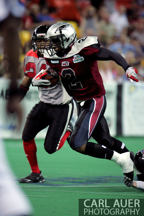 6-28-2007: Anchorage, AK - Alaska's Demarcus Morris (2)  is caught from behind by Quentin Lankford (5) as a teammate comes in to help with the tackle in the Alaska Wild 47 to 53 loss to the CenTex Barracudas at the Sullivan Arena...