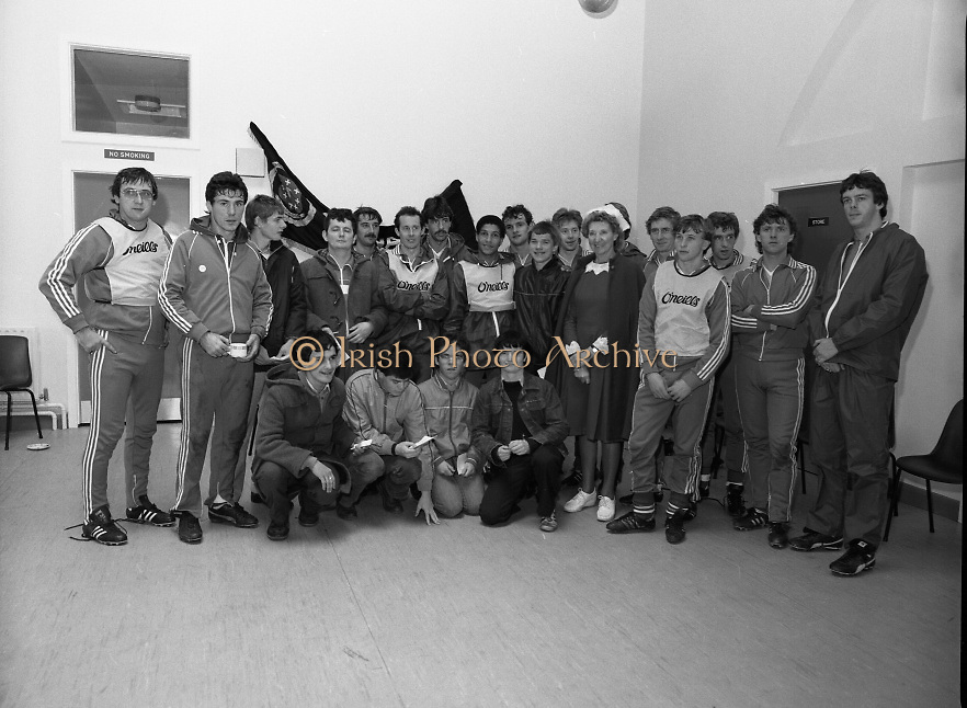 Ireland Soccer Team Training.1983.14.11.1983.11.14.1983.14th November 1983..The Ireland Soccer team trained, for the forthcoming match against Malta, at Stewarts Hospital,Palmerstown Dublin.Image of the manager,players,fans and a nursing sister from Stewarts Hospital as the line up for a group photograph.