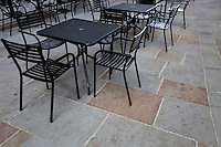 Tables and chairs at outdoor cafe