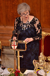 © Licensed to London News Pictures. 12/11/2018. London, UK. British Prime Minister Theresa May makes a speech inside the Great Hall at the Lord Mayor's Banquet held at Guildhall in London, Britain, on Nov. 12, 2018. The 691st Lord Mayor of the City of London, Peter Estlin, will host the annual Lord Mayor's Banquet. Photo credit: Ray Tang/LNP