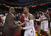 Feb 15, 2018; Los Angeles, CA, USA; Southern California Trojans guard Jordan McLaughlin (11) shakes hands with athletic director Lynn Swann after an NCAA basketball game against the Oregon Ducks  at Galen Center. USC defeated Oregon 72-70.