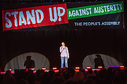 Marcus Brigstocke. The Peoples Assembly  presents: Stand Up Against Austerity. Live at the Hammersmith Apollo. London. © Andrew Aitchison / Peoples Assembly