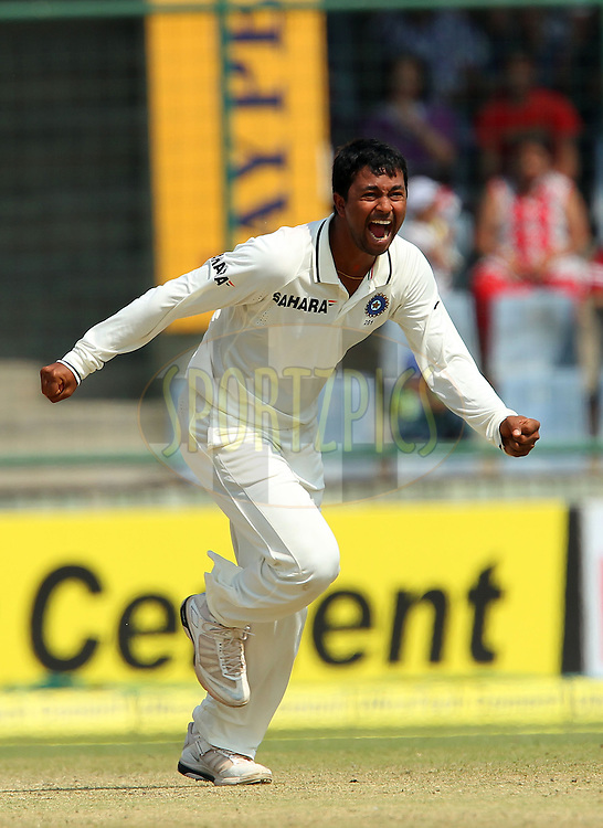 Pragyan Ojha of India celebrates the wicket of Shane Watson of Australia during day 3 of the 4th Test Match between India and Australia held at the Feroz Shah Kotla stadium in Delhi on the 24th March 2013..Photo by Ron Gaunt/BCCI/SPORTZPICS ..Use of this image is subject to the terms and conditions as outlined by the BCCI. These terms can be found by following this link:..http://www.sportzpics.co.za/image/I0000SoRagM2cIEc