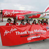 Air Asia stewardress pose in front of their carrier at low cost terminal, Sepang ,Malaysia. Air Asia is Asia's leading low fare, no frills airline based in Malaysia. The airline was established in 1993 and started operations on 18 November 1996. .