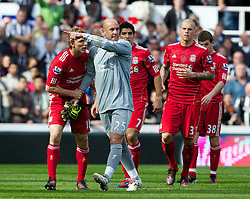 NEWCASTLE-UPON-TYNE, ENGLAND - Sunday, April 1, 2012: Liverpool's goalkeeper Jose Reina points dejected to Newcastle United's James Perch to meet outside the pitch after being sent off, as team-mates Dirk Kuyt, Luis Alberto Suarez Diaz and Martin Skrtel try to calm the Spaniard down, during the Premiership match at St James' Park. (Pic by Vegard Grott/Propaganda)