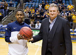 West Virginia Mountaineers guard Juwan Staten (3) is presented a game ball by West Virginia Mountaineers head coach Bob Huggins before Monday's game in Morgantown.