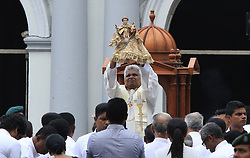 April 28, 2019 - Colombo, Sri Lanka - Sri Lankan catholic priest Fr. Jude Raj Fernando raises the statue of St. Anthony which is claimed to be unharmed despite the bomb explosion that took place one week ago  inside the Anthony's Church in Kochchikade, Colombo, Sri Lanka on 28 April 2019. (Credit Image: © Tharaka Basnayaka/NurPhoto via ZUMA Press)