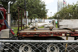 June 20, 2017 - Orlando, Florida, U.S. - 'Johnny Reb' rests on a flatbed truck as workers disassemble the Confederate memorial statue at Lake Eola Park on Tuesday morning. The statue will later be reassembled at Greenwood Cemetery. Confederacy statues are gradually disappearing from the nation's public town squares.  (Credit Image: © Jacob Langston/TNS via ZUMA Wire)