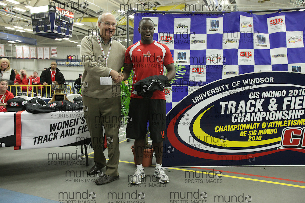 (Windsor, Ontario---13 March 2010) Sam Effah of the University of Calgary accepts the female athlete of the year award at the 2010 Canadian Interuniversity Sport Track and Field Championships at the St. Denis Center. Photograph copyright Geoff Robins/Mundo Sport Images. www.mundosportimages.com
