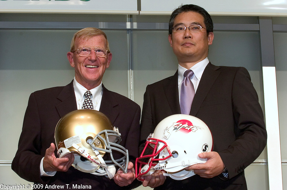 20-FEB-09 Tokyo, Japan.Former Notre Dame head coach Lou Holtz (leftl and Team Japan head coach Kiyoyuki Mori (right) pose for pictures after a press conference at Tokyo Dome, Tokyo, Japan. Holtz will lead the Notre Dame Fighting Irish Legends against Mori's Japan National American Football team in the Notre Dame Japan Bowl, July 25, 2009 at Tokyo Dome..