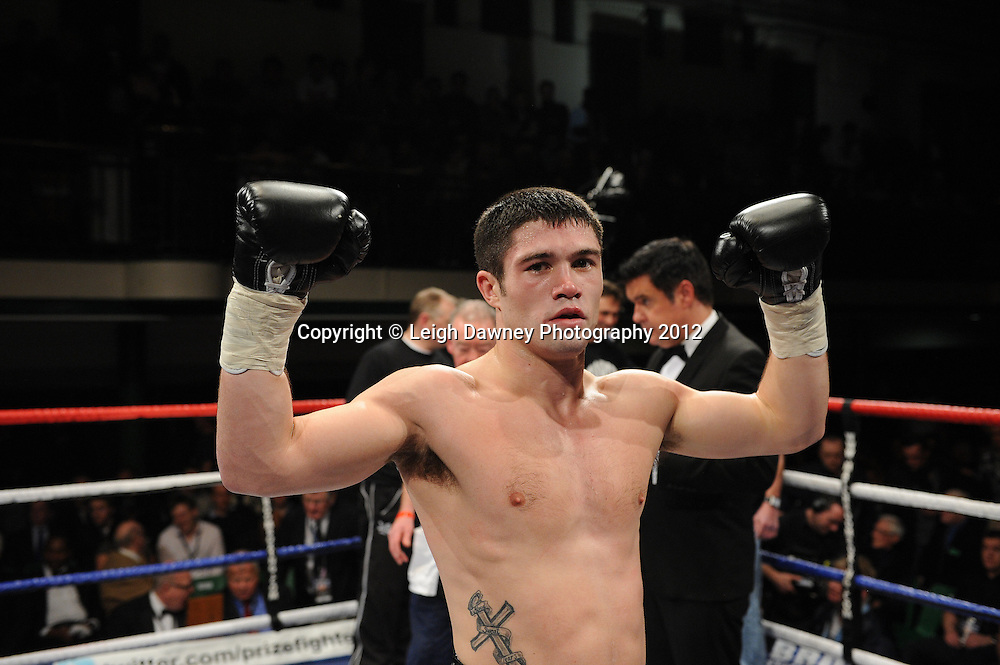 John Ryder (black shorts) defeats Mariusz Biskupski in a 8x3min Middleweight contest at York Hall, Bethnal Green, London on 28th January 2012.Matchroom Sport. © Leigh Dawney Photography 2012.