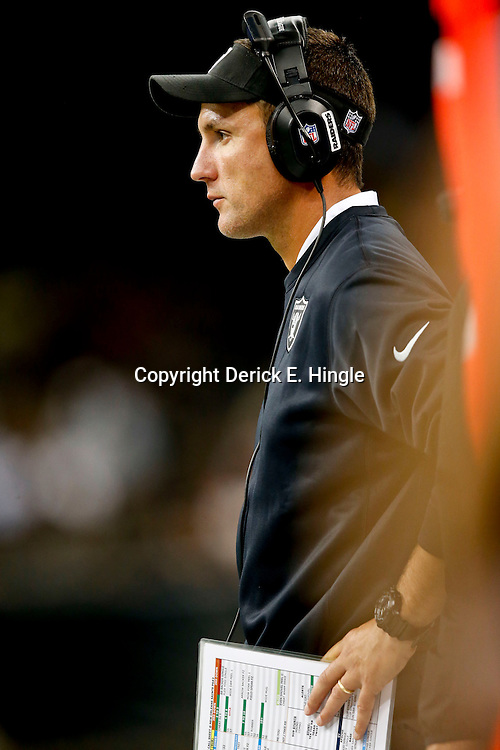 Aug 16, 2013; New Orleans, LA, USA; Oakland Raiders head coach Dennis Allen against the New Orleans Saints during the second half of a preseason game at the Mercedes-Benz Superdome. The Saints defeated the Raiders 28-20. Mandatory Credit: Derick E. Hingle-USA TODAY Sports