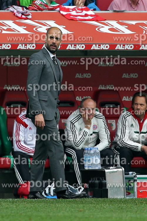 05.04.2014, SGL Arena, Augsburg, GER, 1. FBL, FC Augsburg vs FC Bayern Muenchen, 29. Runde, im Bild Trainer Josep Guardiola (Bayern Muenchen) unzufrieden // during the German Bundesliga 29th round match between FC Augsburg and FC Bayern Munich at the SGL Arena in Augsburg, Germany on 2014/04/05. EXPA Pictures &copy; 2014, PhotoCredit: EXPA/ Eibner-Pressefoto/ Fastl<br /> <br /> *****ATTENTION - OUT of GER*****