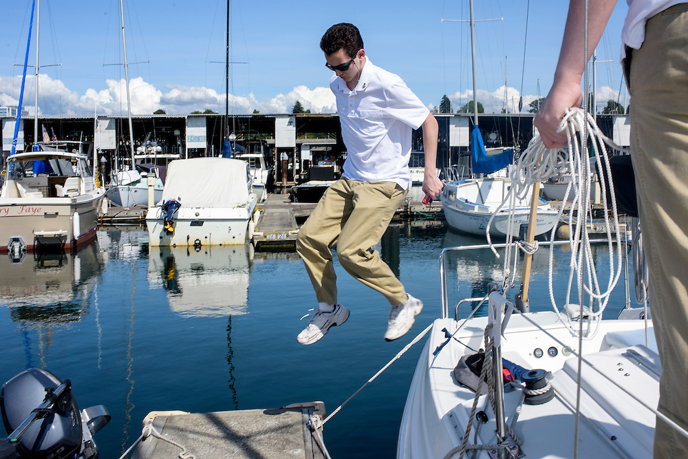 Everett, Washington - July 13, 2015: Dressed in their naval dress uniforms Prince Aaron, left, and King Adam I, right, prep the HMNS (His Magesty's Naval Ship) Bert George at the Port of Everett Marina before venturing into the Possession Sound (part of the Puget Sound). <br /> <br /> The Bert George is named for the Oberstadt brothers&rsquo; grandfather. The crown jewel of the &Uuml;berstadt navy is captained by their father, High Chancellor Michael Oberstadt, not pictured. The High Chancellor does not wear &Uuml;berstadti regalia. <br /> <br /> The Kingdom of &Uuml;berstadt is led by nineteen-year-old King Adam I, (Adam Oberstadt). The Barony of Rosewood -- the micronation's capitol and the Oberstadt family home -- is nestled in the Seattle suburb of Mountlake Terrace, Wash. <br /> &Uuml;berstadt also claims territory of nearby Edmount Island on Lake Ballinger -- called The Barony of Ballinger and &quot;considered the spiritual homeland of the nation.&quot; Both baronies reside within the Duchy of Edmount which &quot;is situated entirely within the boundaries of the city of Mountlake Terrace, Washington,&quot; according to the &Uuml;berstadt website.<br /> &Uuml;berstadt  was founded by King Adam I and his high school friends March 6, 2010, and was governed by judges as a kritarchy. Before taking the crown, Adam was &Uuml;berstadt's chief judge. After graduation, many of the &Uuml;berstadti moved away to college and &Uuml;berstadt's populace shrank. Activities would shift from the high school to Rosewood, and the governing style morphed to a unitary constitutional monarchy. According to the micronation's website &Uuml;berstadt is a sovereign state &quot;guided by the principles of direct democracy, socialist economics, and environmentalism.&quot; <br /> <br /> CREDIT: Matt Roth