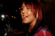 Portrait of a girl with a tongue piercing, UK 2005