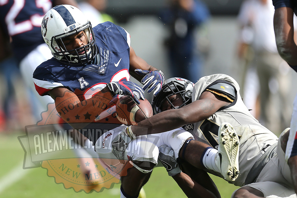 ORLANDO, FL - NOVEMBER 11: Nevelle Clarke #14 of the UCF Knights tackles Arkeel Newsome #22 of the Connecticut Huskies for a loss during a NCAA football game between the University of Connecticut Huskies and the UCF Knights on November 11, 2017 in Orlando, Florida. (Photo by Alex Menendez/Getty Images) *** Local Caption *** Nevelle Clarke; Arkeel Newsome