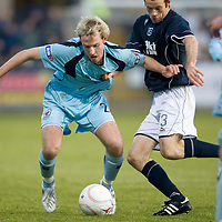 Dundee v St Johnstone....29.11.08<br /> Gary Irvine is pulled by Eddie Malone<br /> Picture by Graeme Hart.<br /> Copyright Perthshire Picture Agency<br /> Tel: 01738 623350  Mobile: 07990 594431