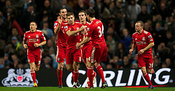 11.01.2012, Etihad Stadion, Manchester, ENG, Carling Cup, Manchester City vs FC Liverpool, Halbfinale, im Bild Liverpool's captain Steven Gerrard celebrates scoring the first goal against Manchester City from the penalty spot with team-mate Martin Kelly, Andy Carroll and Jordan Henderson during the football match of English Carling Cup, Halffinal, between Manchester City and FC Liverpool at Etihad Stadium, Manchester, United Kingdom on 2012/01/11. EXPA Pictures © 2012, PhotoCredit: EXPA/ Propagandaphoto/ David Rawcliff..***** ATTENTION - OUT OF ENG, GBR, UK *****
