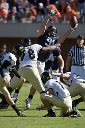 Virginia defensive end Chris Long (91) partially deflects a Wake Forest kicker Sam Swank (38) field goal.  The try was no good.  The #23 Virginia Cavaliers defeated the #24 Wake Forest Demon Deacons 17-16 at Scott Stadium in Charlottesville, VA on November 3, 2007.