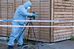 A forensics investigator photographs a knife found on Brookdale Road, an adjacent side street, following a stabbing at a Costa Cafe On Bowes Road, Arnos Grove  in which a male victim has been left in critical condition. Arnos Grove, North London, November 12 2018.