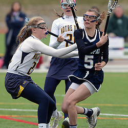 Staff photos by Tom Kelly IV<br /> Episcopal's Jane Crager (5) gets checked by Notre Dame's SJ Quigley (22) during the Episcopal Academy at Notre Dame girls lacrosse game on Tuesday afternoon, March 31, 2015.