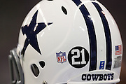 IRVING, TX - NOVEMBER 29: A Dallas Cowboys helmet contains the number 21 decal that was added to commemorate recently shot and murdered defensive back Sean Taylor of the Washington Redskins during the game against the Green Bay Packers on November 29, 2007 at Texas Stadium in Irving, Texas. The Cowboys defeated the Packers 37-27. ©Paul Anthony Spinelli
