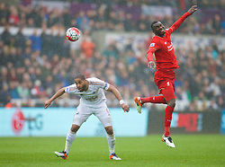 SWANSEA, WALES - Sunday, May 1, 2016: Liverpool's Christian Benteke in action against Swansea City's captain Ashley Williams during the Premier League match at the Liberty Stadium. (Pic by David Rawcliffe/Propaganda)