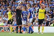 Ipswich Town midfielder Flynn Downes is shown a yellow card by Referee Ross Joyce during the EFL Sky Bet League 1 match between Burton Albion and Ipswich Town at the Pirelli Stadium, Burton upon Trent, England on 3 August 2019.