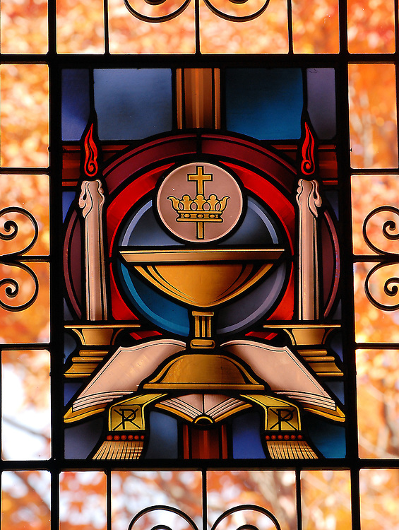 Stained glass image depicting Sacrament of the Eucharist. (Sam Lucero photo)