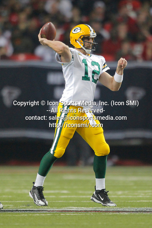 15 January 2011: Green Bay Packers quarterback Aaron Rodgers (12) drops back to pass in the Green Bay Packers 48-21 victory over the Atlanta Falcons in the NFC Divisional playoff at the Georgia Dome in Atlanta Georgia.
