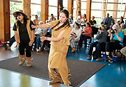 First Nations dancers perform at the SLCC  on National Aboriginal Day.  Squamish Lil'wat Cultural Centre.  Whistler BC, Canada