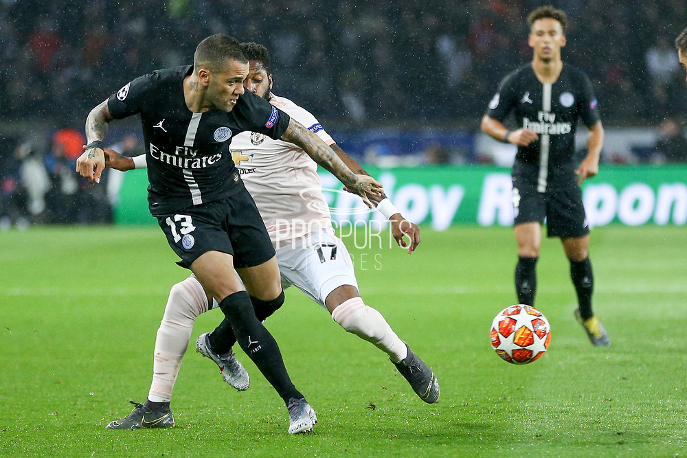 Dani Alves of Paris Saint-Germain crosses the ball against Manchester United Midfielder Fred during the Champions League Round of 16 2nd leg match between Paris Saint-Germain and Manchester United at Parc des Princes, Paris, France on 6 March 2019.