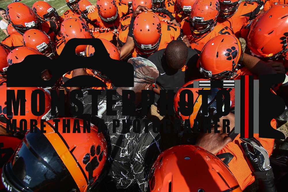 Tigers head coach Preston Brown, CENTER, prays with his team prior to a non-conference game between The Woodrow Wilson Tigers and The Northern Burlington Greyhounds Saturday, Sept. 17, 2016, at Mike Rozier Stadium in Camden, NJ.<br /> <br /> Preston Brown, told his players he would be doing so in order to highlight issues of social injustice in Camden.