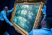 "Sotheby's London Exhibition of Sale Highlights from the Forthcoming Major New York Auctions of Contemporary and Impressionist and Modern Art, including exceptional Diamonds from Geneva. The auctions will include: $25-35 million masterpiece by Gerhard Richter; Major works by Matisse and Léger never before offered at auction; a Claude Monet  - Le Pont japonais $12-18m (pictured); a Giacometti sculpture; The ""Graff Vivid Yellow""  -  At 100.09 carats, one of the rarest yellow diamonds of its size (est. $15-25 million); The Victory Diamond - A 31.34-carat diamond named to commemorate the Allied Victory in World War II ($5-8 million); and one of the world's largest known round brilliant-cut diamonds weighing 103.46 carats (est. $3.5-5 million). They will take place in New York and Geneva 11-15 April 2014. Sotheby's, New Bond St, London, UK."