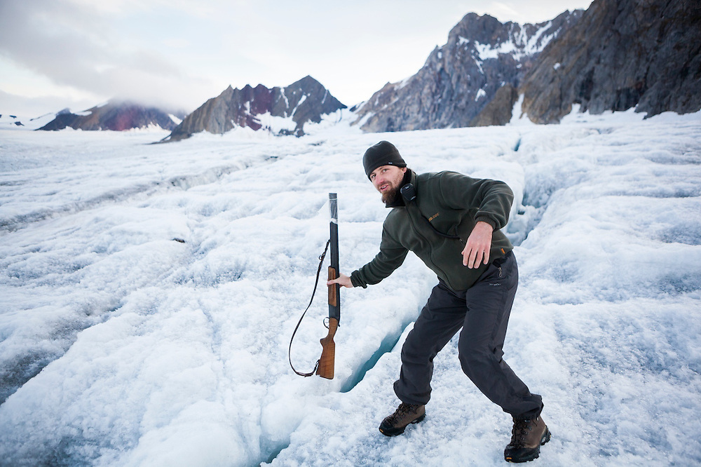Acoustics specialist Krysztof Herman (helping out with glacier field work) navigates the crevassed surface of Samarinbreen, Hornsund, Svalbard using his (polar bear) rifle as a probe.