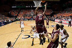 Virginia Tech forward J.T. Thompson (33) goes up for an offensive rebound against Virginia.  The Virginia Cavaliers men's basketball team fell to the Virginia Tech Hokies 70-69 in overtime at the John Paul Jones Arena in Charlottesville, VA on January 16, 2008.