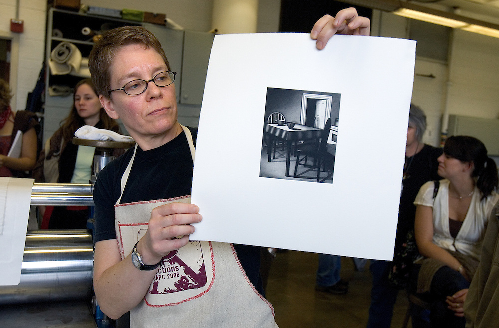 """Printmaker Janet Ballweg shows a print she just made during the 2006 Mid America Print Council conference """"Forging Connections"""" at Ohio University on Friday, 9/22/06. The conference runs from September 20-23. Around 700 printmakers, students, curators and other art professionals are expected to attend the biennial event."""