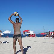 Locals play beach volleyball at Copacabana beach, Rio de Janeiro,  Brazil. 4th July 2010. Photo Tim Clayton..