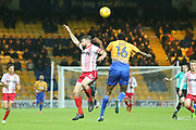 Danny Newton of Stevenage (19) and Hayden White of Mansfield Town (16) battle for a cross during the EFL Sky Bet League 2 match between Mansfield Town and Stevenage at the One Call Stadium, Mansfield, England on 18 November 2017. Photo by Mick Haynes.