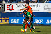 Luton Town forward Danny Hylton tackles Coventry City forward Bright Enobakhare (24) during the EFL Sky Bet League 1 match between Luton Town and Coventry City at Kenilworth Road, Luton, England on 24 February 2019.