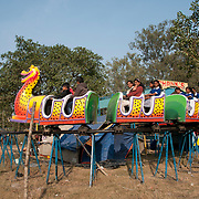 India. Bihar. Bodhgaya. Funfair. Dragon ride.