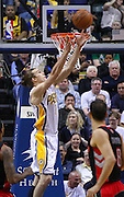 April 09, 2012; Indianapolis, IN, USA; Indiana Pacers center Louis Amundson (17) catches the alleyoop pass against the Toronto Raptors at Bankers Life Fieldhouse. Mandatory credit: Michael Hickey-US PRESSWIRE