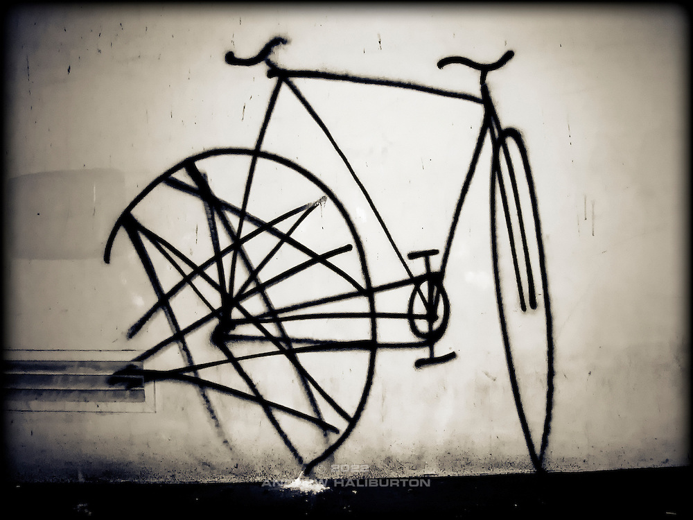 Front wheel turned.  Graffiti on downtown wall featuring a bicycle with front wheel turned, San Francisco, California, USA.