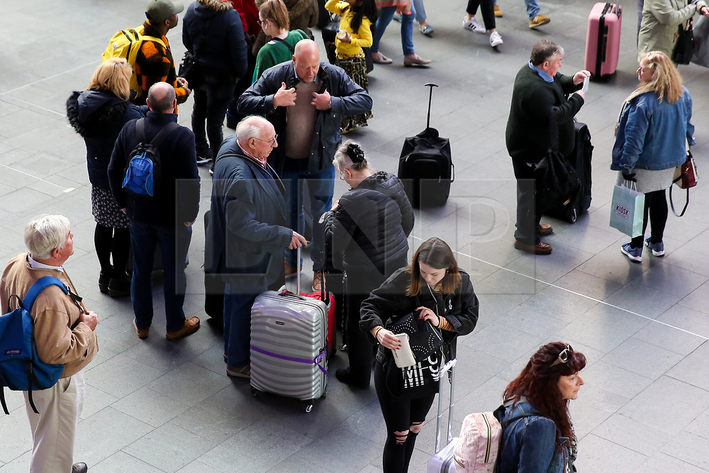 © Licensed to London News Pictures. 04/05/2019. London, UK. Travellers on Kings Cross rail station concourse travelling for the May Bank holiday weekend. According to the Met Office many parts of the UK will have snow, hail and thunder for the weekend and the temperature for the May Bank holiday could drop to as low as -6 degrees celsius. Photo credit: Dinendra Haria/LNP