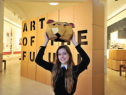 Pictured: Charly Miller, an S5 pupil from Drummond Community High School in Edinburgh with a golden bear head which forms part of the exhibition.<br /> <br /> 'The Art of the Future' was an ambitious project that asked young people across Scotland what they thought the art of the future was. The results are in a display opening at the Scottish National Gallery in Edinburgh this week.<br /> <br /> © Dave Johnston / EEm