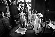 Girls visiting the bathroom before their first Holly Communion at Notre Dame du Sacre-Coeur in Brussels.